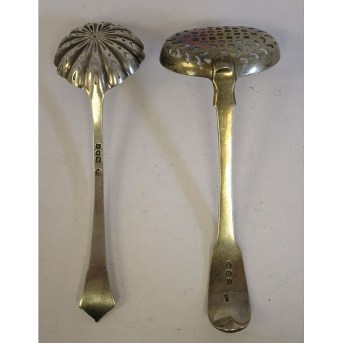 46 - A George III silver fiddle pattern sifter spoon, the shallow, oval bowl with uniform perforationsT...