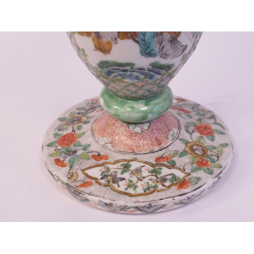 48 - A late 19thC Chinese porcelain trumpet shaped vase, decorated with figures in relief, on a splayed c...