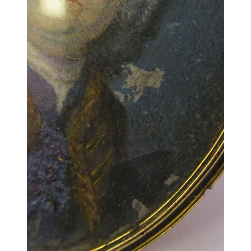51 - A 19thC oval portrait miniature, a bewigged man, wearing a brown topcoat and cravat, in a yellow met...