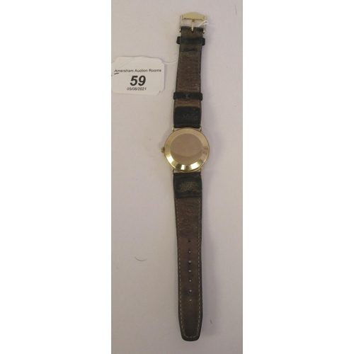 59 - An Omega 9ct gold cased wristwatch, the automatic movement with sweeping seconds, faced by an Arabic...