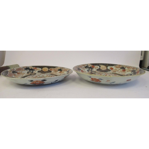 60 - A matched pair of 18thC Japanese Imari porcelain footed dishes, each decorated in gilded iron red an...