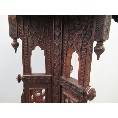 58 - A late 19thC Anglo-Indian profusely floral carved and decoratively pierced hardwood torchere, the he...