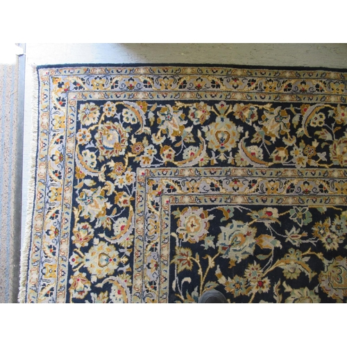 55 - A Keshan carpet, decorated with dense floral motifs, on a blue ground 157