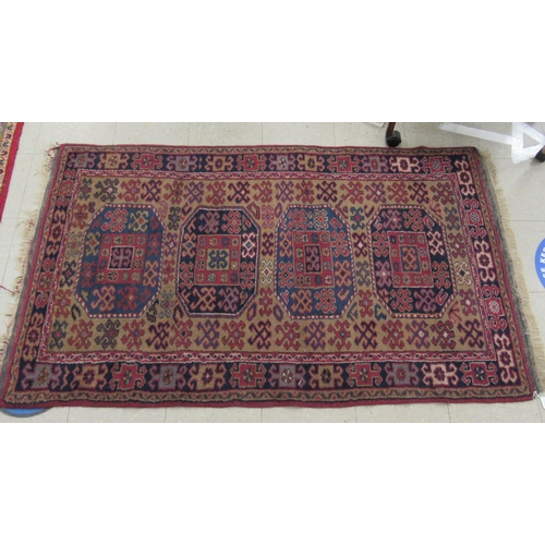 59 - A Persian runner, decorated with elephant foot motifs, on a red and blue ground 69