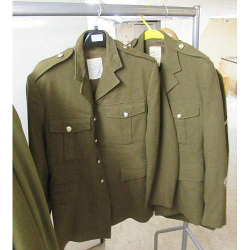 30 - Nine Army dress tunics, some bearing labels, some with matching trousers various sizes