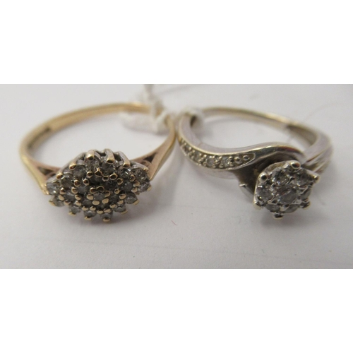 48 - A 9ct white gold crossover set diamond cluster ring; and another similar