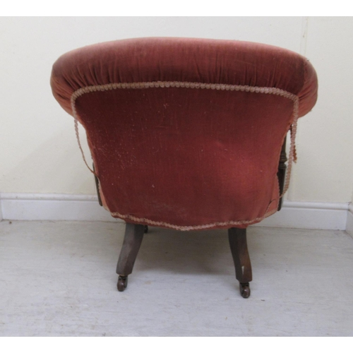 7 - A Victorian horseshoe back, mahogany framed boudoir chair, part button upholstered in salmon pink fa...