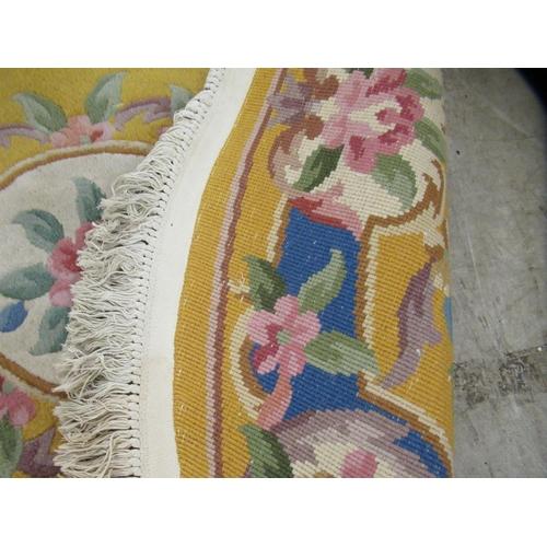 56 - A modern fringed, multi-coloured, floral patterned rug 64