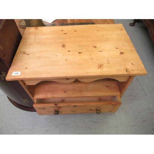 50 - Small furniture: to include a pine television stand with an open shelf and base drawer, on a plinth...