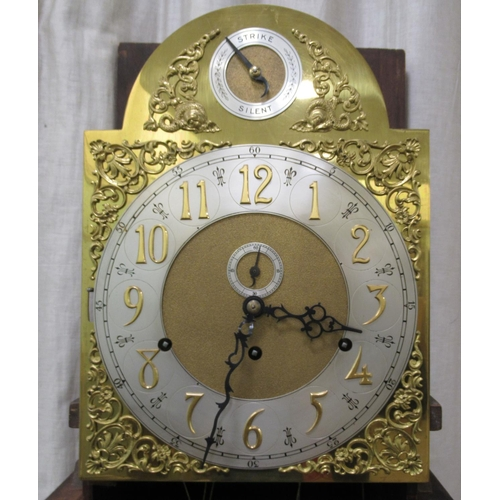 54 - An Edwardian string inlaid mahogany longcase clock, the arched hood with a glazed window, over a str...