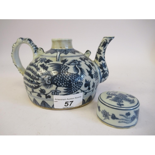 57 - A Provincial Chinese porcelain teapot of squat, circular form, having a cover, loop handle and swept...