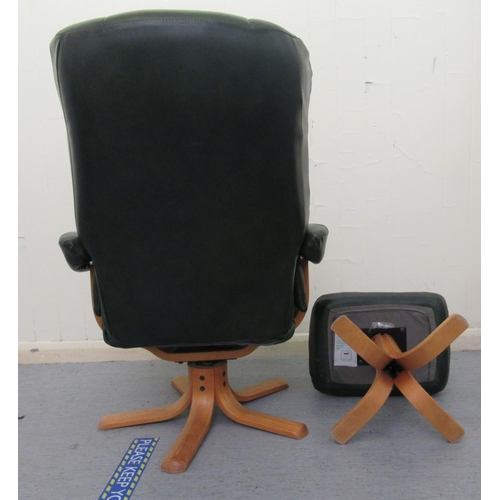 22 - A modern stitched green hide upholstered chair, raised and rotating on a splayed beech base with a m...