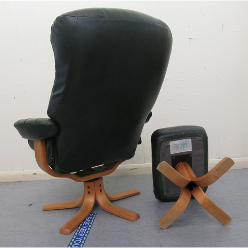 23 - A modern stitched green hide upholstered chair, raised and rotating on a splayed beech base with a m...