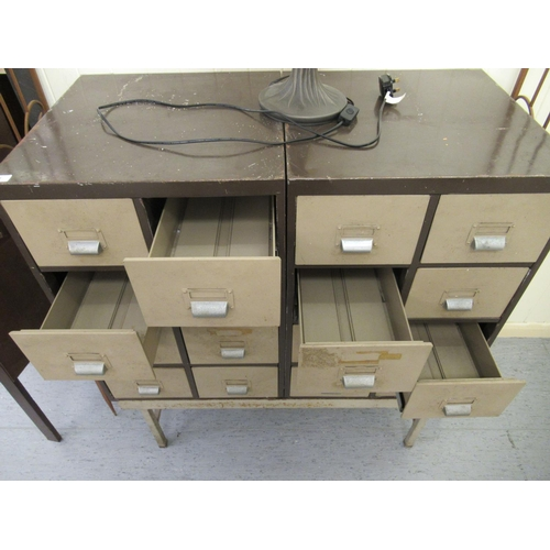25 - An HSLD Industrially inspired, twin bank, eight drawer filing cabinet, on a painted metal underframe...