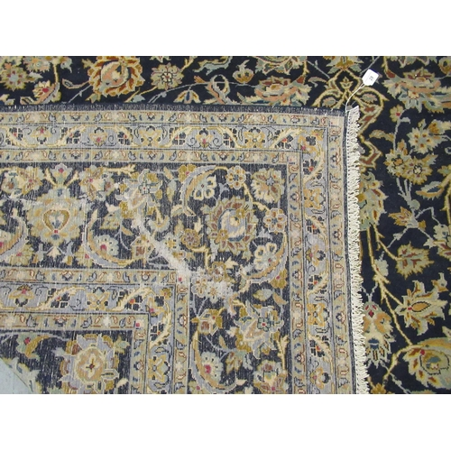 28 - A Keshan carpet, decorated with dense floral motifs, on a blue ground 157