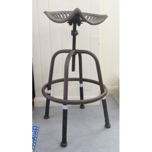 3 - A modern patinated cast metal, tractor design stool with a rotating, height adjustable seat