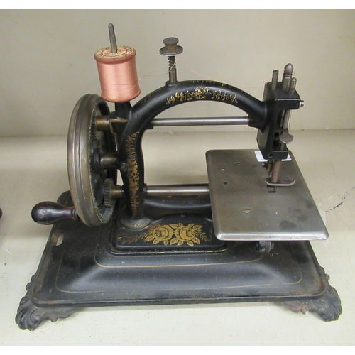 35 - An early/mid 19thC National Express gilded cast iron manual sewing machine bears a wax seal, s...