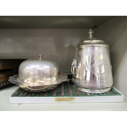 37 - EPNS tableware: to include a biscuit barrel; a muffin dish and cover; and flatware