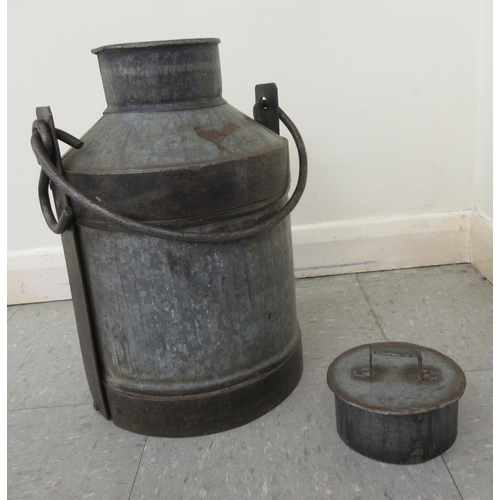 5 - A galvanised metal milk churn with a folding top handle 17