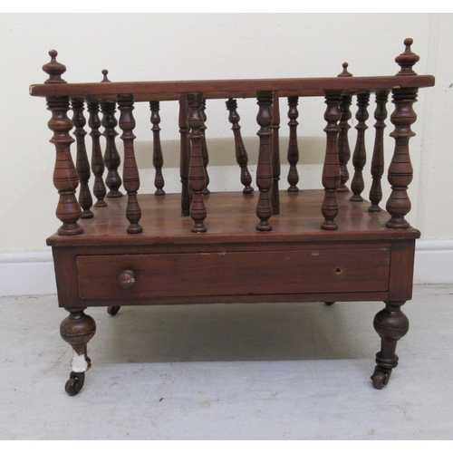 52 - A late Victorian walnut Canterbury with three sections and pillar uprights, on a box drawer base, ra...