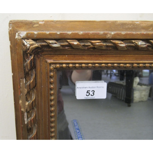 53 - A late Victorian overmantel mirror, in a gilded gesso frame 31