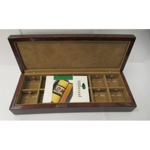 54 - A gentleman's Hillswood of London burr veneered luxury jewellery casket with a fabric lined and comp...