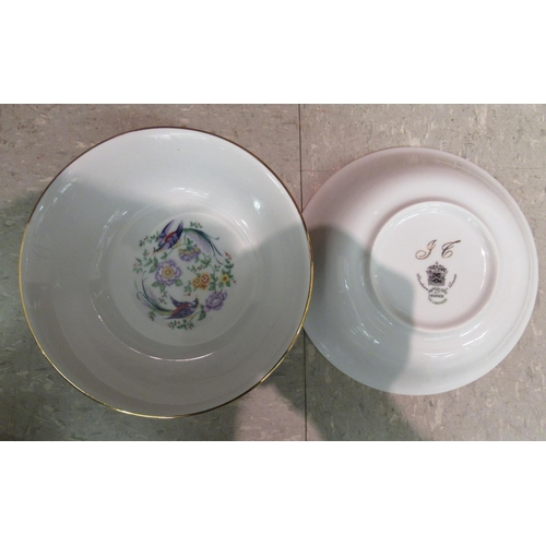 6 - A Limoges porcelain dinner service, decorated with birds of paradise and flora