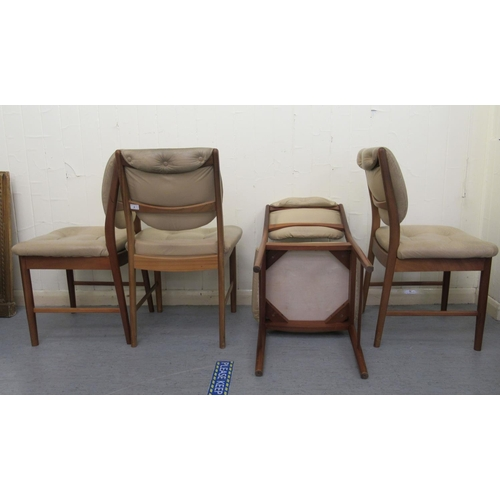 9 - A set of four 1970s teak framed dining chairs, the part button upholstered, beige hide backs and sea...