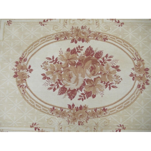42 - A Belgian design wall hanging with floral decoration, on a beige ground 89