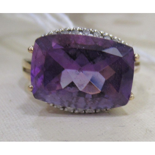 1 - A 9ct gold amethyst and diamond ring