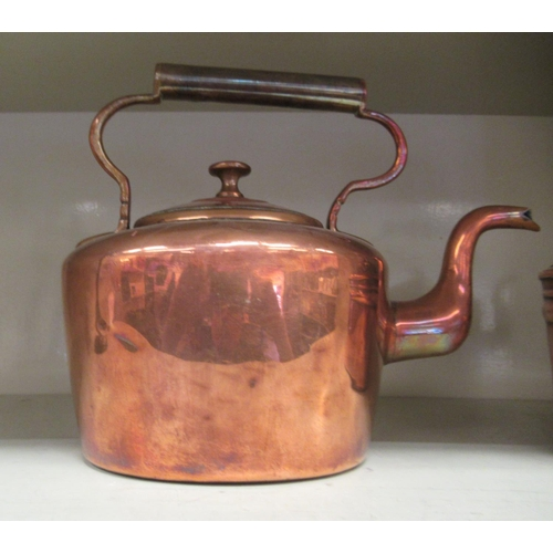 10 - Two late Victorian copper kettles, each with a fixed top handle