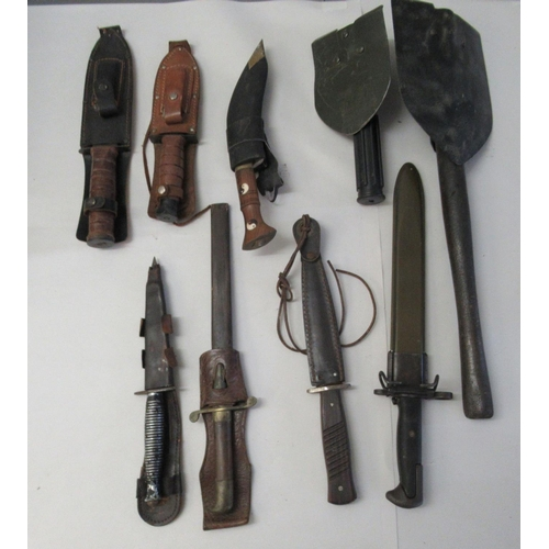 12 - Military style and other daggers; and two trenching tools (Please Note: this lot is offered su...