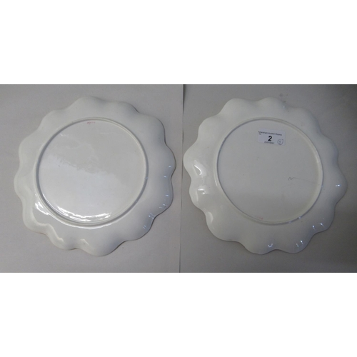 2 - A pair of late 19thC porcelain plates, each decorated with loch scenes 9