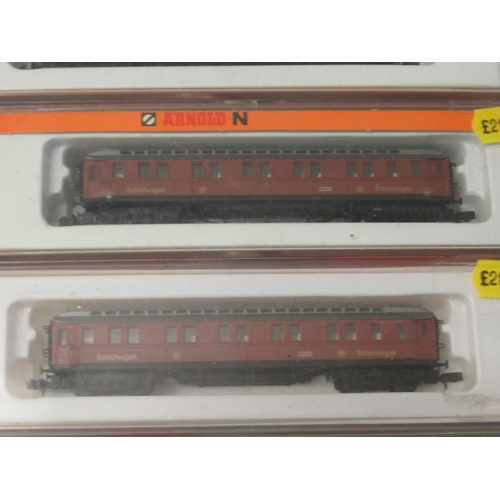 23 - N gauge model railway accessories: to include four Arnold passenger coaches boxed