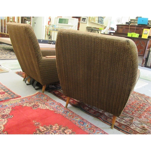 27 - A pair of 1960s/1970s three tone, textured fabric upholstered, low, enclosed armchairs with panelled...
