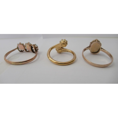 29 - Three yellow metal rings and a white metal coloured ring, set with simulated pearls, opals and other...