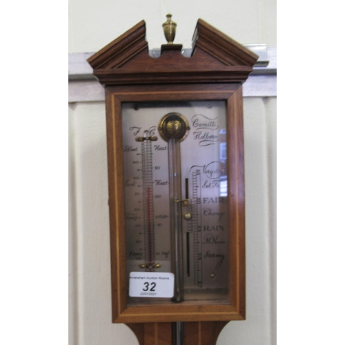 32 - An Edwardian Comitti of Holborn crossbanded and string inlaid satin mahogany cased stick barometer, ...
