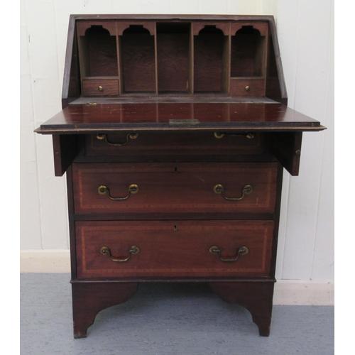 35 - An Edwardian crossbanded string inlaid mahogany bureau bookcase, the fall flap over three long drawe...