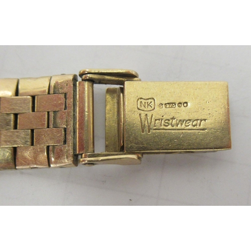 40 - A lady's Ebel 9ct gold cased wristwatch, faced by a baton dial, on a 9ct gold flexible strap