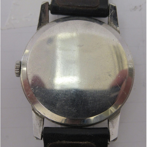 41 - An Omega stainless steel cased wristwatch, faced by an Arabic dial with subsidiary seconds, on a bla...