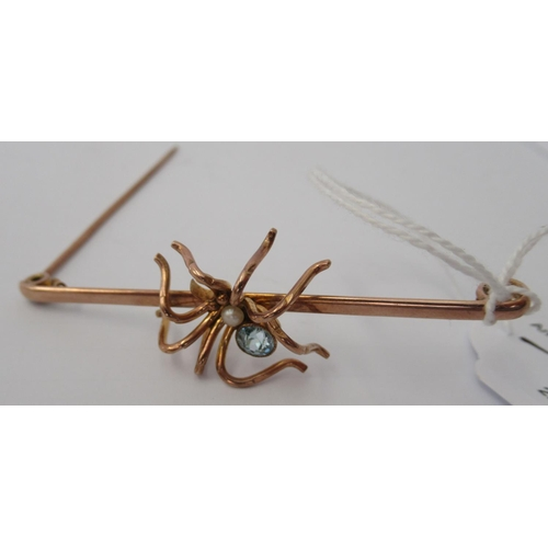 47 - A 9ct gold scarf pin, surmounted by a spider, set with a seed pearl and coloured stone boxed