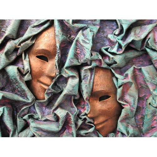 50 - A modern 3D abstract work, in relief with two masks amongst waves mixed media bears an indistinct ...