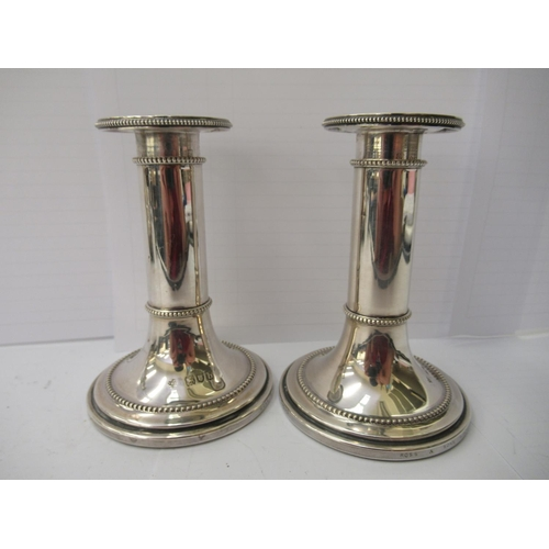 56 - Silver and silver plated tableware: to include a pair of Polish silver plated, on copper candlestick...