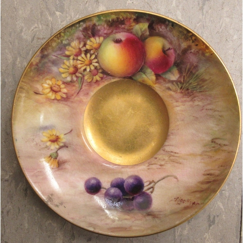 11 - A Royal Worcester china matched pedestal coffee cup and saucer, decorated with soft fruit and gildin...