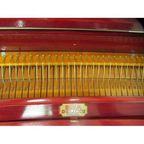 29 - A modern Bina deluxe harmonium, model no.23, retracting into a red stained pine portable table cabin...