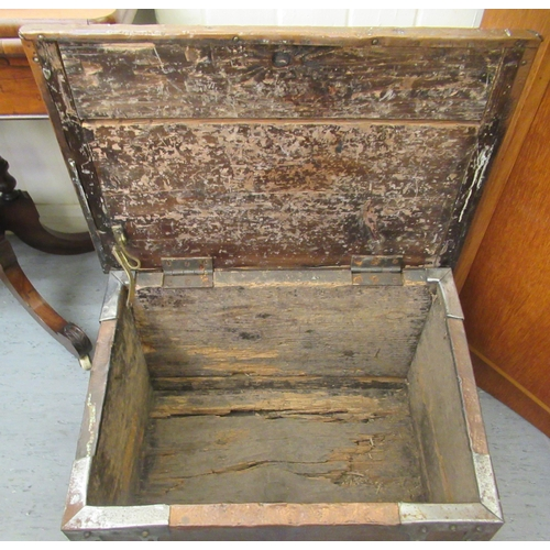 1 - An early 20thC Arts & Crafts copper clad coal bin incorporating an angled, hinged lid, wrought m...