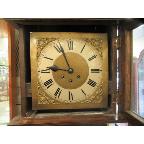 16 - A 1920s/30s oak cased grandmother clock; the weight driven Westminster chime movement faced by a Rom...