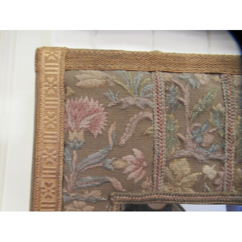 2 - An early 20thC bevelled mirror, set in a wide, tapestry fabric covered frame 34'' x 21''