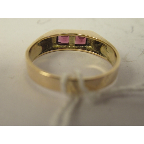 28 - A rose gold coloured signet style ring, set with two pink stones