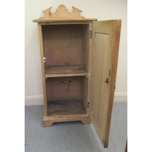 31 - A late Victorian pine bedside cabinet with a single door, on a plinth 29''h 15''w